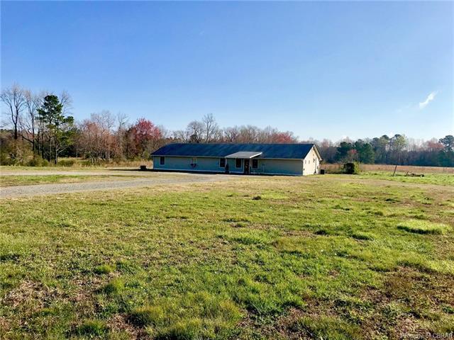 8215 General Puller Highway, Hartfield, VA 23169 (MLS #1812392) :: The Ryan Sanford Team