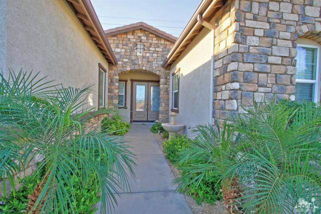 81949 Il Serenada Drive, La Quinta, CA 92253 (MLS #218028420) :: Brad Schmett Real Estate Group