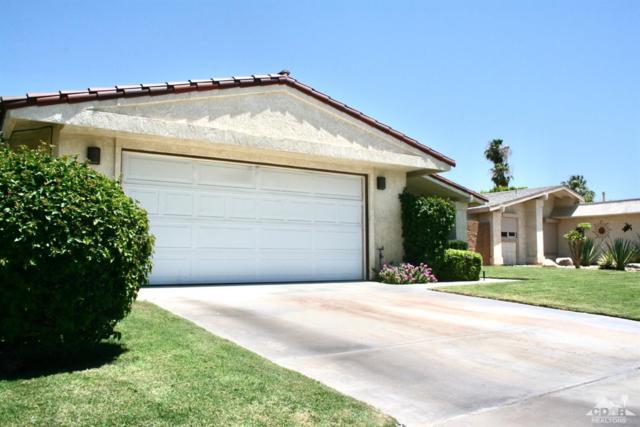 77596 Edinborough Street, Palm Desert, CA 92211 (MLS #219000427) :: The Jelmberg Team