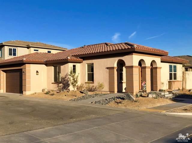 74414 Millennia Way, Palm Desert, CA 92211 (MLS #219024293) :: The John Jay Group - Bennion Deville Homes