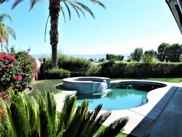77040 Utah Circle, Palm Desert, CA 92211 (MLS #219047091) :: KUD Properties