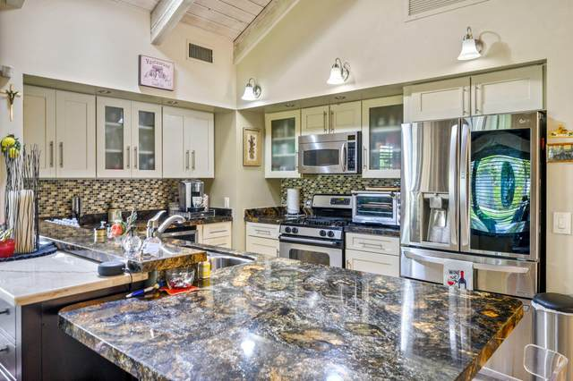 131 S Racquet Club Drive, Rancho Mirage, CA 92270 (MLS #219047121) :: The John Jay Group - Bennion Deville Homes