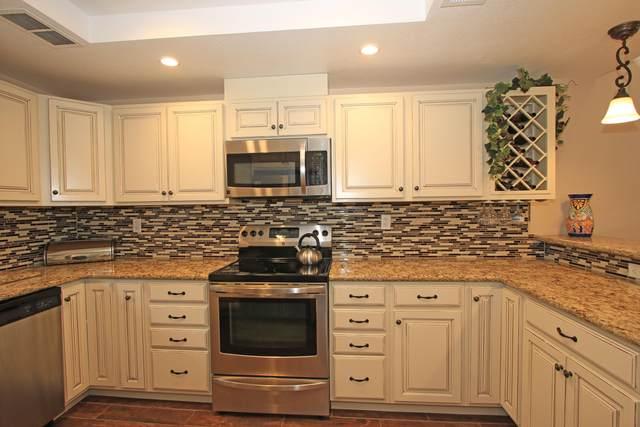 302 S Sierra Madre, Palm Desert, CA 92260 (MLS #219056940) :: KUD Properties