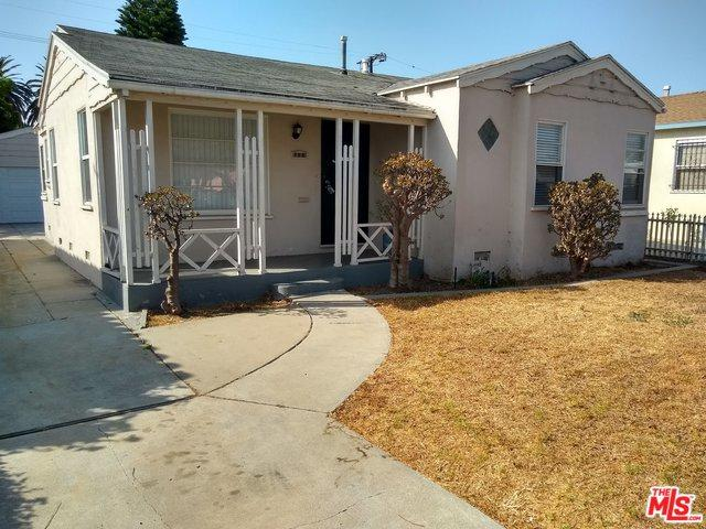 720 W 104th Place, Los Angeles (City), CA 90044 (MLS #18389044) :: The John Jay Group - Bennion Deville Homes