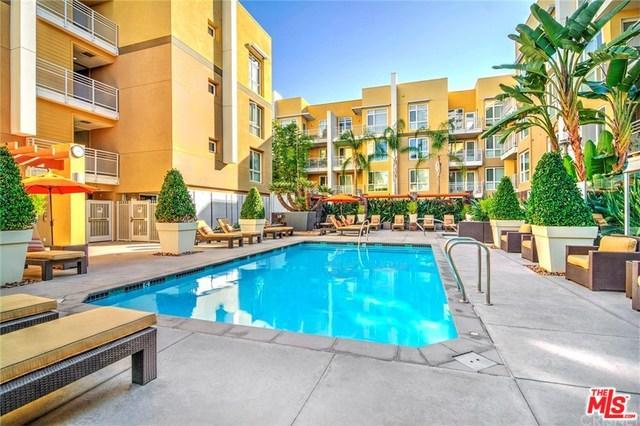 21301 Erwin Street #313, Woodland Hills, CA 91367 (MLS #19474046) :: The John Jay Group - Bennion Deville Homes
