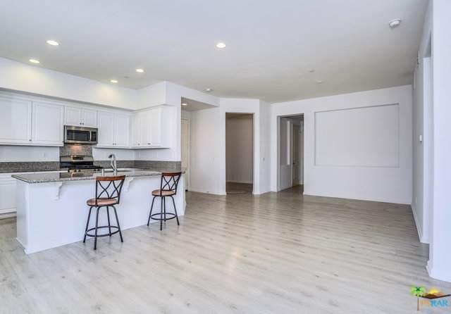 2601 Via Calderia, Palm Desert, CA 92260 (MLS #19501278PS) :: The John Jay Group - Bennion Deville Homes