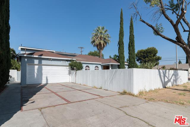 7355 Garden Grove Avenue, Reseda, CA 91335 (MLS #18386914) :: The Jelmberg Team