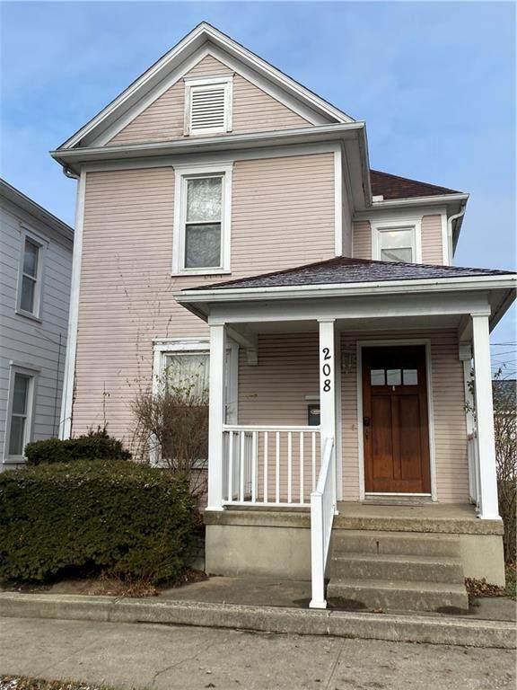 208 E High Street, Piqua, OH 45356 (MLS #832027) :: The Gene Group
