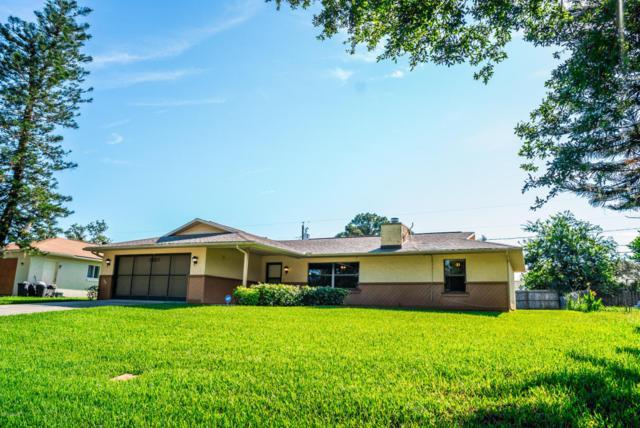 3027 Yule Tree Drive, Edgewater, FL 32141 (MLS #1045276) :: Beechler Realty Group