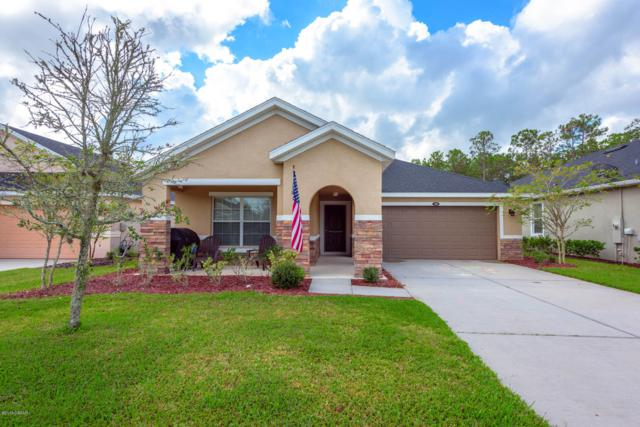 309 Grande Lake Drive, Daytona Beach, FL 32124 (MLS #1049480) :: Memory Hopkins Real Estate