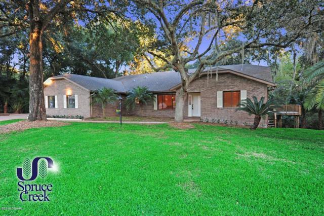 2630 Spruce Creek Boulevard, Port Orange, FL 32128 (MLS #1060183) :: Cook Group Luxury Real Estate