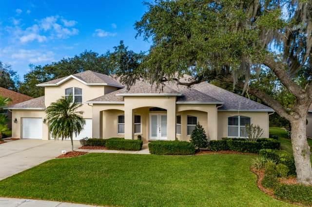 6063 Sabal Creek Boulevard, Port Orange, FL 32128 (MLS #1067963) :: Memory Hopkins Real Estate