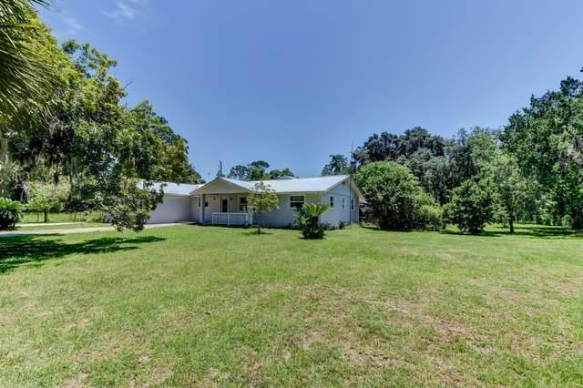 6021 Spruce Creek Road, Port Orange, FL 32127 (MLS #1069955) :: Memory Hopkins Real Estate