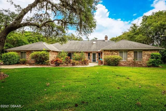 5819 Spruce Creek Woods Drive, Port Orange, FL 32127 (MLS #1082813) :: Cook Group Luxury Real Estate