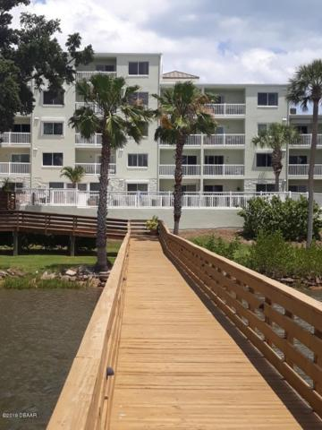 711 N Halifax Avenue #203, Daytona Beach, FL 32118 (MLS #1057075) :: Memory Hopkins Real Estate