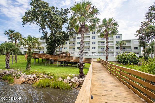711 N Halifax Avenue #103, Daytona Beach, FL 32118 (MLS #1058034) :: Memory Hopkins Real Estate