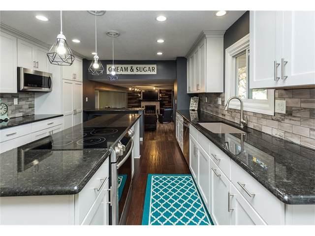 9713 Madison Avenue, Urbandale, IA 50322 (MLS #551389) :: Pennie Carroll & Associates