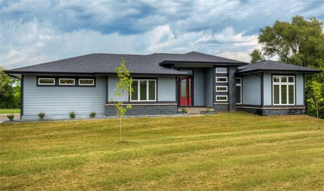 655 Indian Ridge Drive, Waukee, IA 50263 (MLS #555507) :: Pennie Carroll & Associates