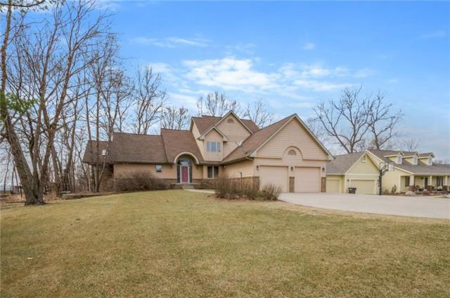 8516 NW Beaver Drive, Johnston, IA 50131 (MLS #556951) :: Moulton & Associates Realtors