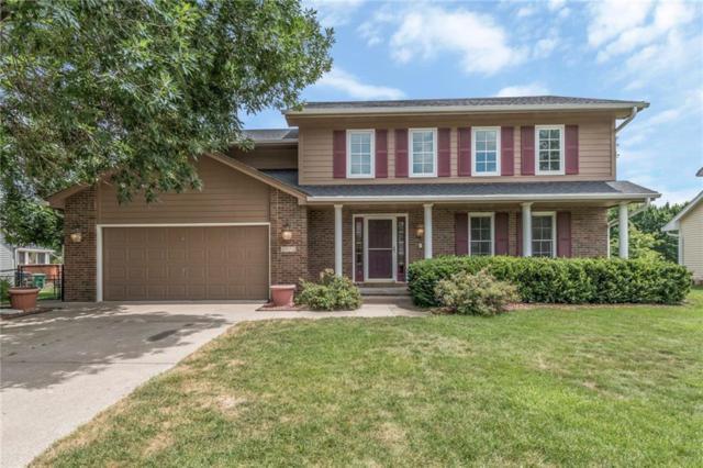 5975 S Winwood Drive, Johnston, IA 50131 (MLS #565520) :: Pennie Carroll & Associates