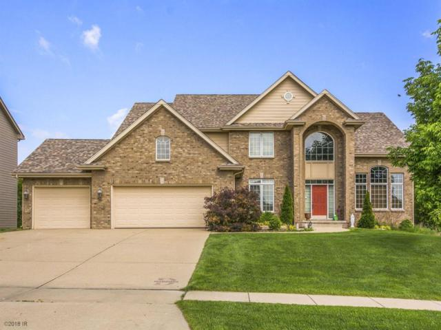 15007 Wilden Drive, Urbandale, IA 50323 (MLS #571073) :: Moulton & Associates Realtors