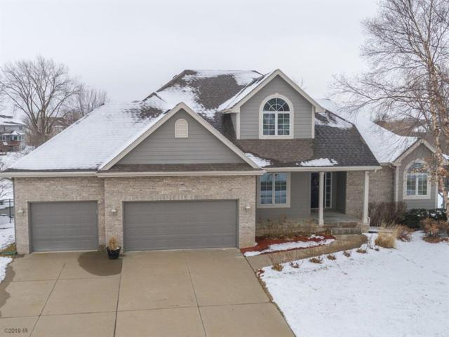 9509 NW Newgate Drive, Johnston, IA 50131 (MLS #575444) :: Moulton & Associates Realtors