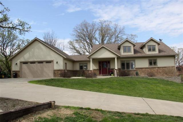 9324 N 101st Avenue W, Baxter, IA 50028 (MLS #581755) :: Pennie Carroll & Associates