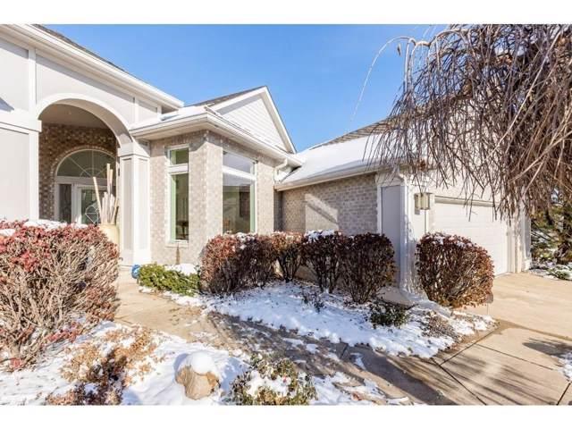 13508 Village Court, Clive, IA 50325 (MLS #594854) :: Moulton Real Estate Group