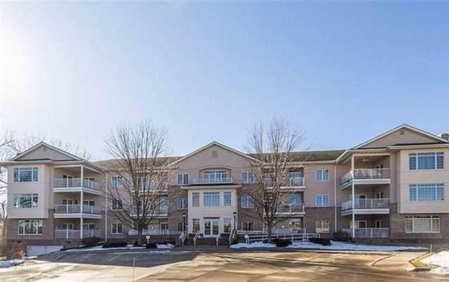 14100 Pinnacle Pointe Drive #204, Clive, IA 50325 (MLS #595423) :: Pennie Carroll & Associates