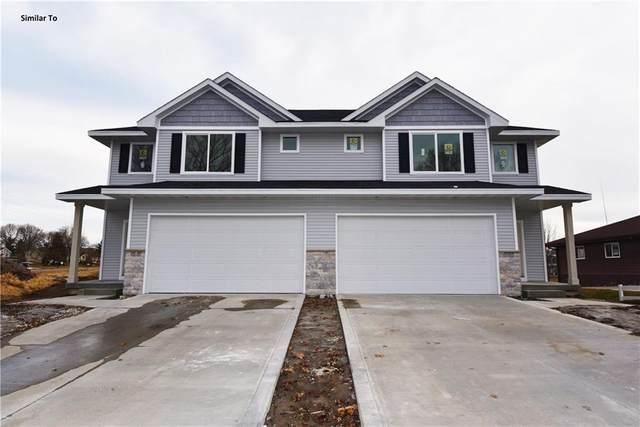 4752 E Oakwood Drive, Pleasant Hill, IA 50327 (MLS #602066) :: Moulton Real Estate Group