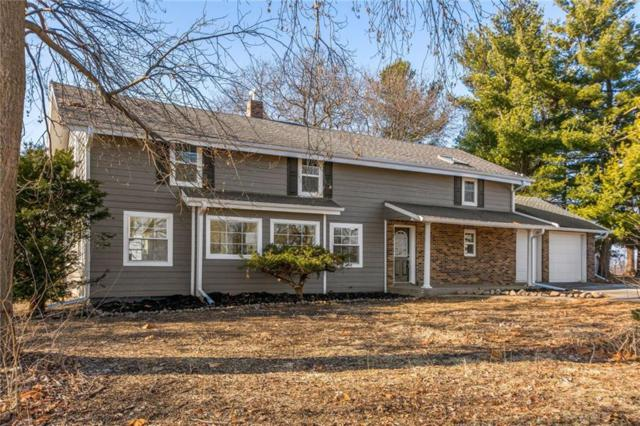 7504 NE University Avenue, Pleasant Hill, IA 50327 (MLS #574710) :: Better Homes and Gardens Real Estate Innovations