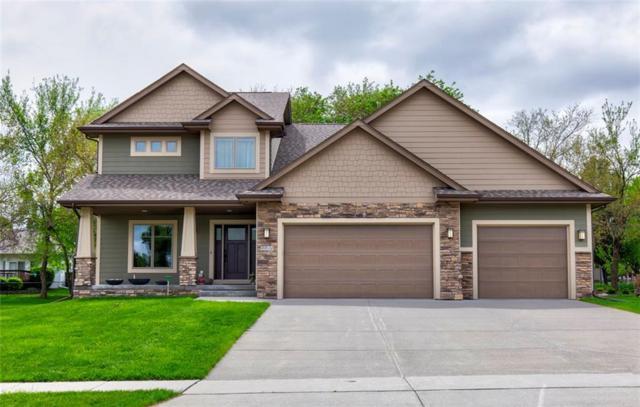 8910 Wooded Point Drive, Johnston, IA 50131 (MLS #582869) :: Pennie Carroll & Associates