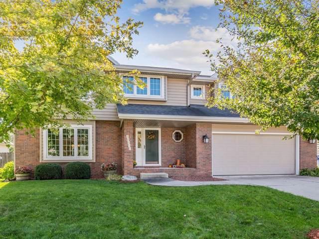 10010 Tanglewood Drive, Urbandale, IA 50322 (MLS #593491) :: Pennie Carroll & Associates