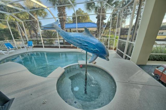 7123 Dolphin Bay Boulevard, Panama City Beach, FL 32407 (MLS #792110) :: RE/MAX By The Sea