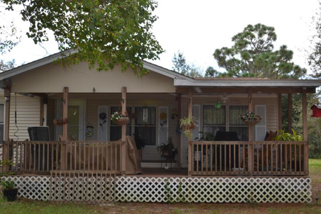 8401 Tortuga Street, Navarre, FL 32566 (MLS #809481) :: ResortQuest Real Estate
