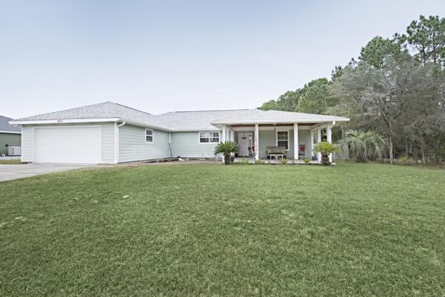 8670 Estrada Street, Navarre, FL 32566 (MLS #811376) :: ResortQuest Real Estate