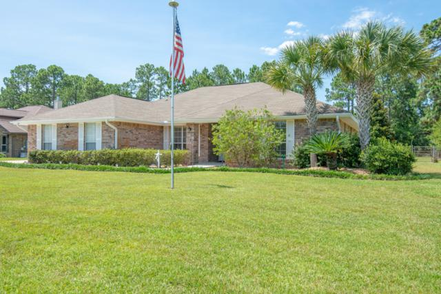 7754 Seaward Street, Navarre, FL 32566 (MLS #825162) :: Keller Williams Emerald Coast
