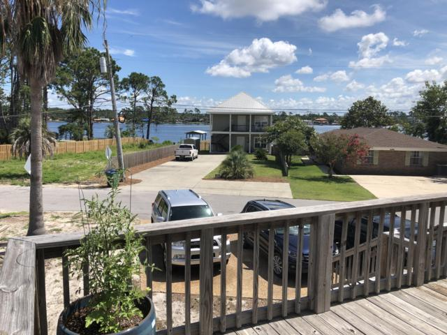 5607 S Lagoon Drive, Panama City Beach, FL 32408 (MLS #825472) :: Rosemary Beach Realty