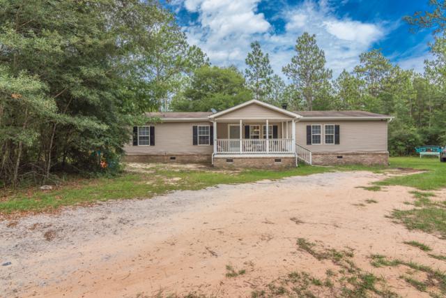 904 Hiawatha Street, Holt, FL 32564 (MLS #825858) :: Berkshire Hathaway HomeServices Beach Properties of Florida