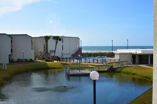 8727 Thomas Drive Unit B7, Panama City Beach, FL 32408 (MLS #840122) :: Berkshire Hathaway HomeServices PenFed Realty