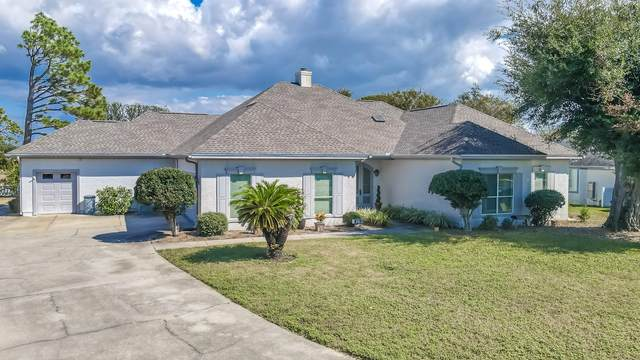 820 Dolphin Drive, Panama City Beach, FL 32408 (MLS #857288) :: Vacasa Real Estate