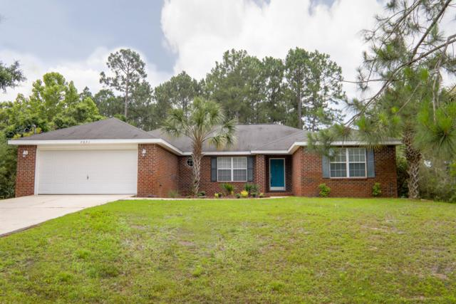 7071 Snug Waters Road, Navarre, FL 32566 (MLS #804916) :: Luxury Properties Real Estate