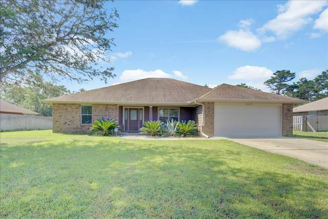 6639 Castlewood Street, Navarre, FL 32566 (MLS #879769) :: Beachside Luxury Realty