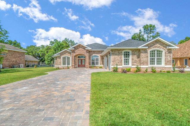 2795 Masters Boulevard, Navarre, FL 32566 (MLS #812910) :: ResortQuest Real Estate