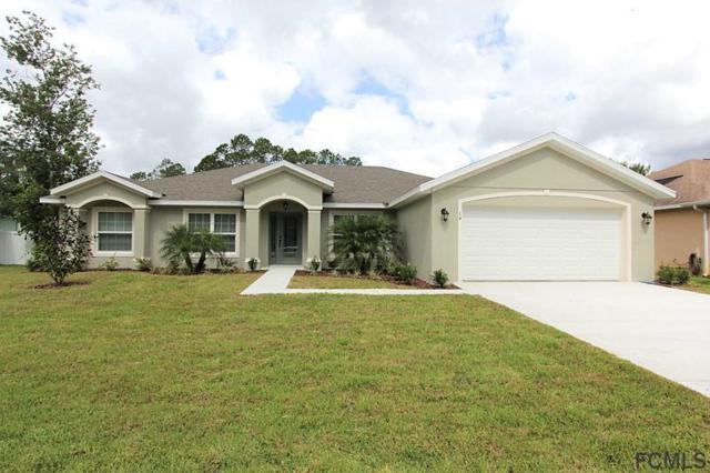 14 Ebb Tide Drive, Palm Coast, FL 32164 (MLS #240700) :: Memory Hopkins Real Estate