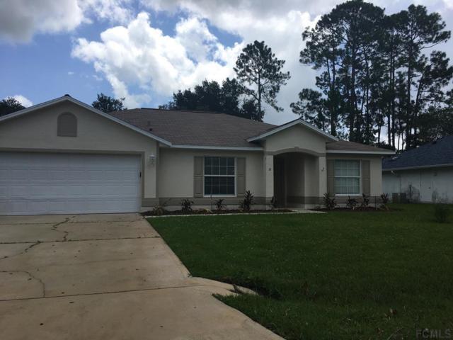 18 Woodstone Lane, Palm Coast, FL 32164 (MLS #240705) :: Memory Hopkins Real Estate