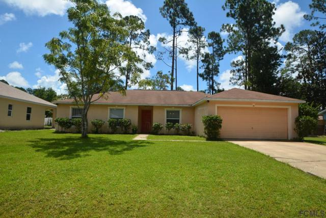 14 Barrington Dr, Palm Coast, FL 32137 (MLS #240844) :: Memory Hopkins Real Estate