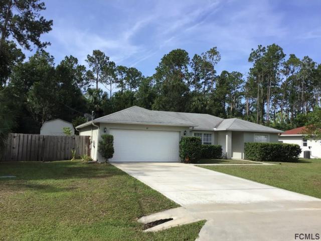 42 Smith Trl, Palm Coast, FL 32164 (MLS #248950) :: Noah Bailey Real Estate Group