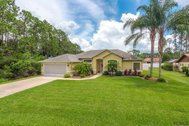 9 Becker Ln, Palm Coast, FL 32137 (MLS #248992) :: Noah Bailey Real Estate Group
