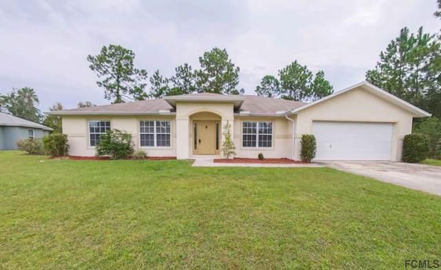 42 White Dove Ln, Palm Coast, FL 32164 (MLS #251369) :: Noah Bailey Group